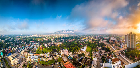 CHIANG MAI, THAILAND- AUGUST 7, 2018 : Aerial Panorama View of Chiang Mai City with sunrise and clouds, Thailand.
