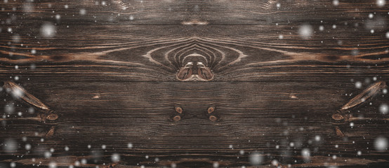 view from above of a hard wood, time aged old, rustic, dark brown wooden background, snow effect
