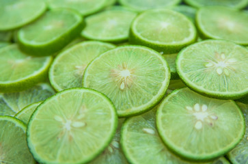 Citrus fruit of lime slices background