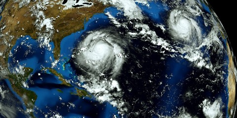 Extremely detailed and realistic high resolution 3D illustration of 2 hurricanes approaching the USA. Shot from Space. Elements of this image are furnished by Nasa.