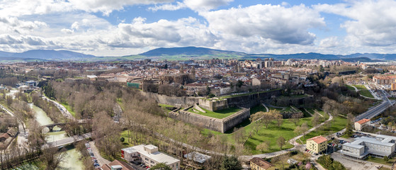 Aerial panorama view of fortified medieval Pamplona in Spain with dramatic cloudy blue sky