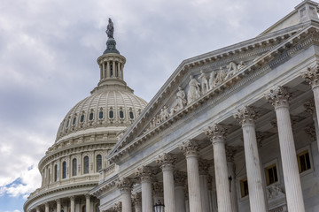 US Capitol Senate building in Washington DC with light blue sky