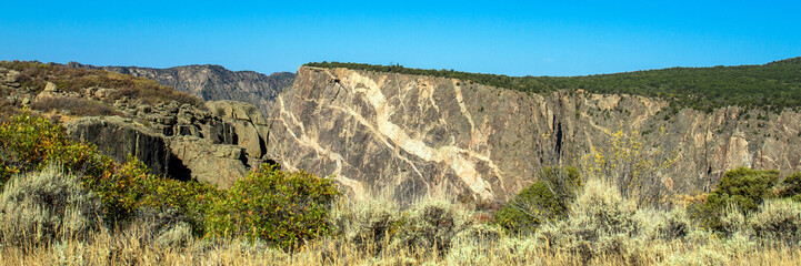 "Famous ""painted wall"" geological markings on a sheer cliff in Black Canyon of the Gunnison National Park in Colorado"