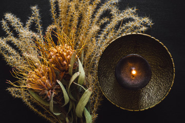 Brass Bowl with Black Candle and Dried Feather Grass and Flowers
