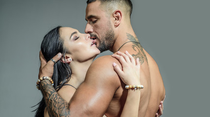 Sensual couple kiss. I Love You. Couple In Love. Romantic and love concept. Hugs together and sensual touch. Sexually explicit. Passionate lover caressing arousing beautiful woman. Dominant man.