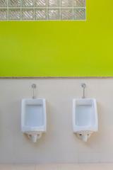 white urinals in men's bathroom, design of white ceramic urinals for men in toilet room