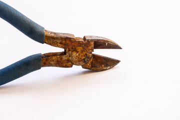 Isolated old rusted wire cutters on white background.
