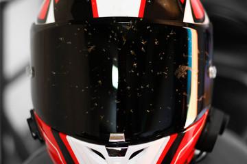 Dirty motorcycle helmet. Helmet in dead flies. Helmet after the race