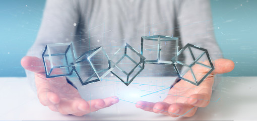 Man holding a 3d rendering blockchain cube isolated on a background