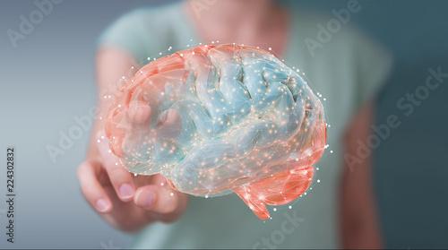 Wall mural Businesswoman using digital 3D projection of a human brain 3D rendering