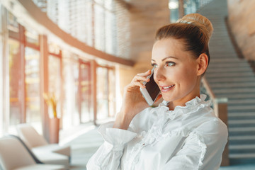 woman using mobile phone in the office