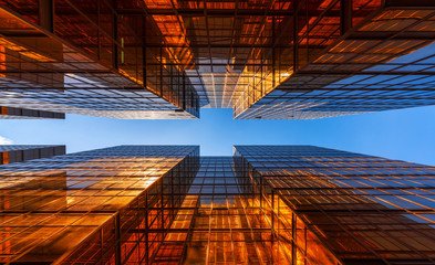Golden building with blue sky. Windows glass of modern office skyscrapers. facade design. Architecture exterior for cityscape background. Fototapete