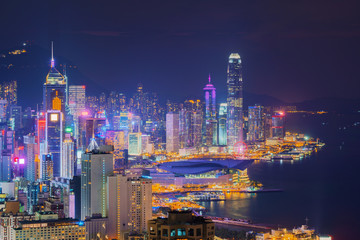 Fototapeta Hong Kong Downtown and Victoria Harbour. Financial district in smart city. Skyscraper and high-rise buildings. Aerial view at night.