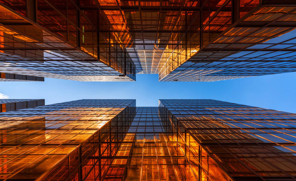 Golden building with blue sky. Windows glass of modern office skyscrapers. facade design. Architecture exterior for cityscape background.