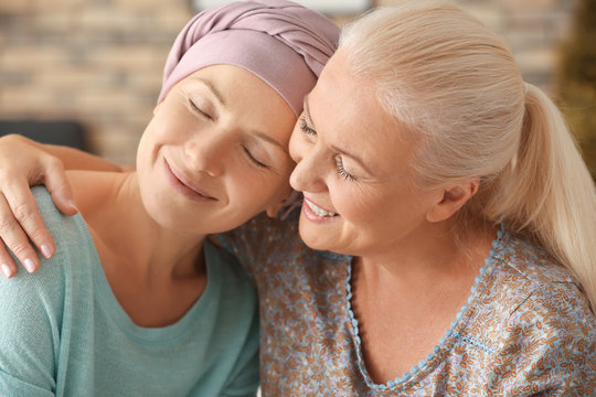 Mother with her daughter after chemotherapy at home