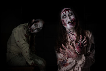 Two scary zombie in darkroom ,people make up for Halloween.