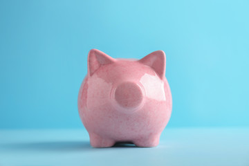 Piggy bank on color background