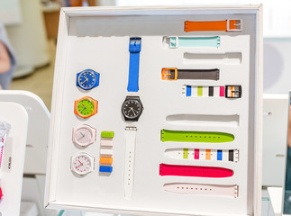 colorful vivid wristwatches at the counter in shop