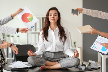 Fotobehang Zen Businesswoman with a lot of work to do meditating in office