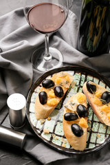 Tasty sandwiches with cheese and grape on plate