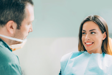 Dentist with female patient