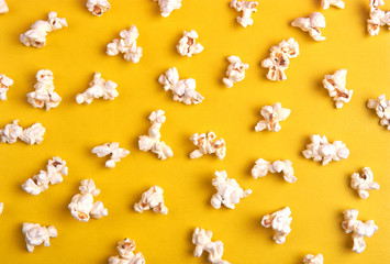 popcorn on a yellow background as a background