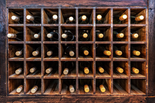 Collection of bottles of wine on wooden cases