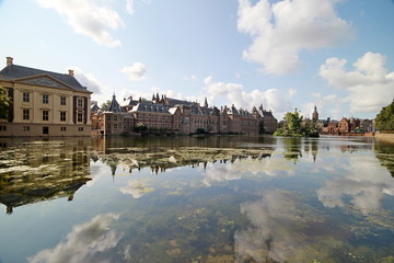 the government and Parliament buildings in The Hague reflection on the water of pool Hofvijver in the Netherlands