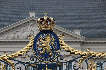 "Crest of the Netherlands with text ""Je maintiendrai"" (I will enforce) on fence of palace Noordeinde in The Hague in the Netherlands."