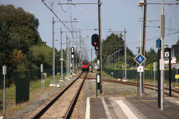 R-Net train on a single track which splits at the platforms of station Boskoop in the Netherlands between Gouda and Boskoop