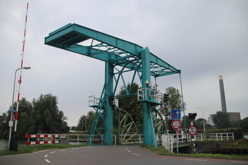 Blue steel drawbridge named Werkspoorhavenbrug at the Keulsekade in Utrecht, the Netherlands.
