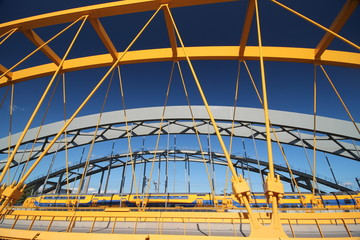 Bright yellow bridge named Hogeweidebrug over the Amsterdam-Rhine canal in Utrecht for traffic in the Netherlands
