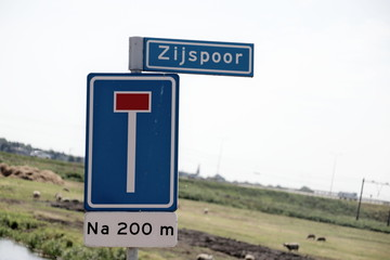 "Dead end street sign with name of street ""zijspoor"" in dutch which means in english ""sidetrack""."