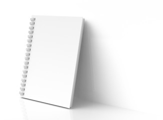 White hard cover book lean on wall