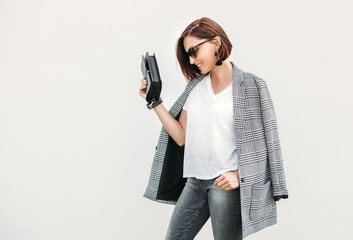 Wall Mural - Woman in gray and black city casual outfit