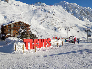 Ski station of Tignes in winter, letters Tignes