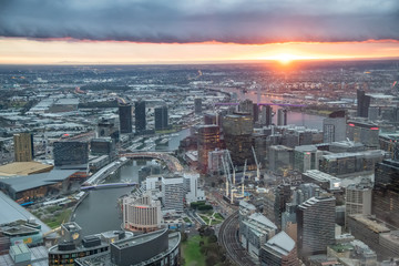 City skyscrapers and Yarra river aerial view at sunset from high point of view, Melbourne