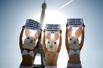 Activists from the People for the Ethical Treatment of Animals (PETA) demonstrate with slogans in protest of the designers use of fur, during the Paris Fashion Week, in front of the Eiffel Tower, in Paris