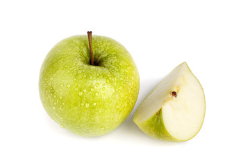 Whole green apple and quater of apple on white background isolated close up macro