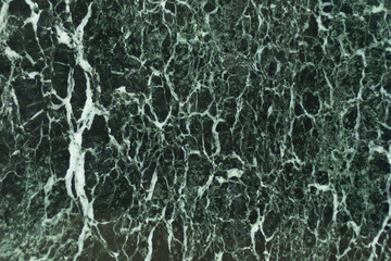 The dark green marble. Facing stone. Texture