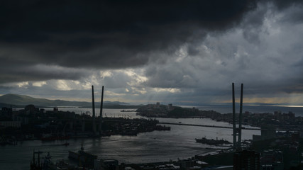 Wall Mural - Vladivostok cityscape - storm and rain over city.