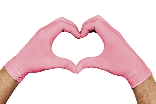 Hands in pink medical gloves showing heart sign isolated on white background