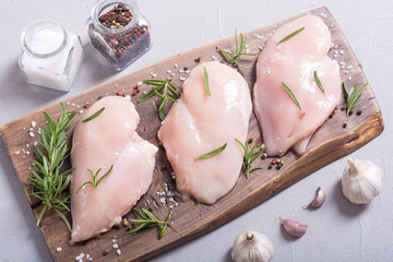 Raw chicken breast ( fillet ) with ingredient