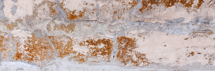 A panoramic photo of the background of an old shabby wabi sabi wall