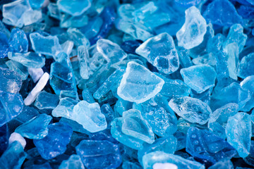 Blue broken glass pieces