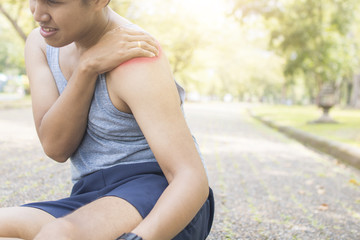 sport people  has shoulder injury after running and work out in morning, man exercise and pain