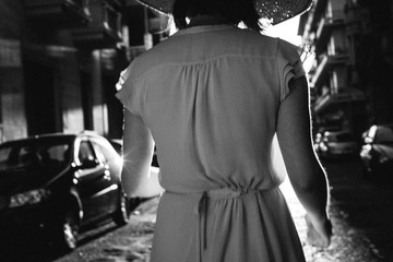 Walking girl from the back in black and white