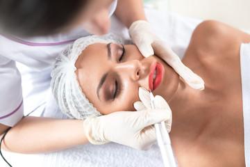 Enhancing lips appearance  on a beautiful woman