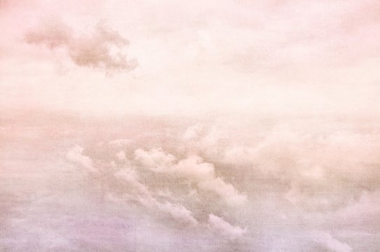 Purple sky with white clouds in retro grunge style. Nature background.
