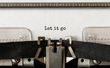Text Let it go typed on retro typewriter